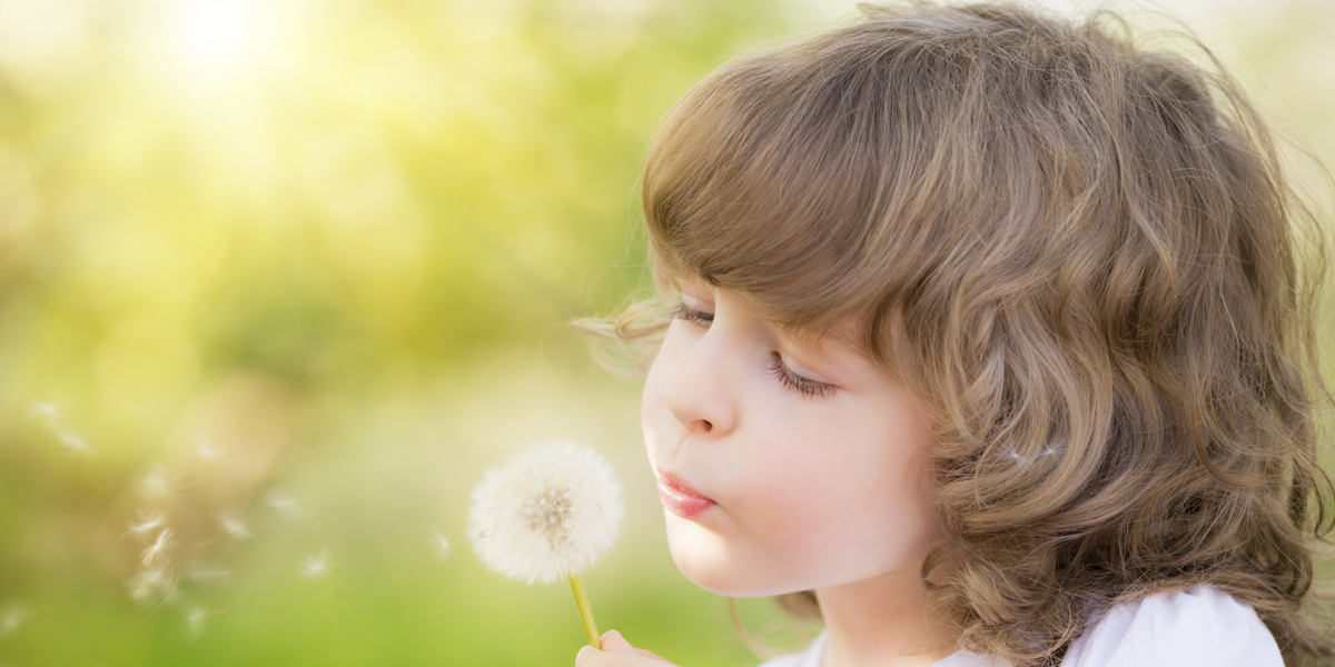 Happy child blowing dandelion_thinkstock_480256981_1200x600.jpg