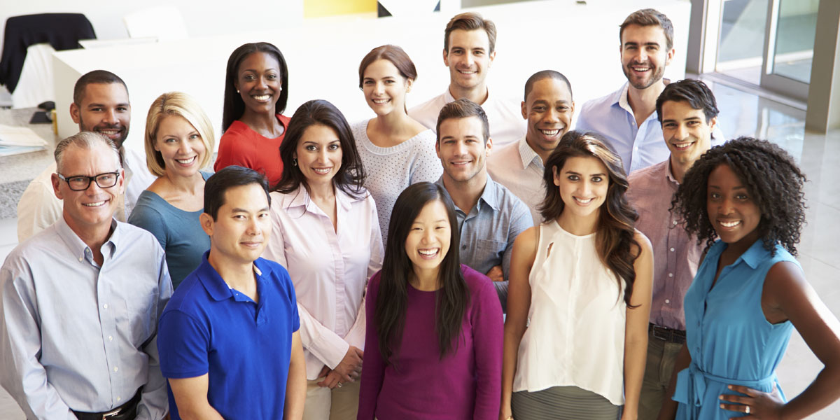 Portrait Of Multi-Cultural Office Staff Standing In Lobby_Thinkstock_469617289_1200x600.jpg