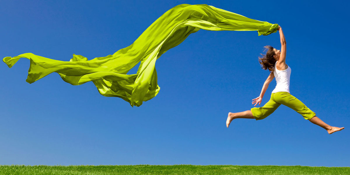 woman jumping in wind_ shutterstock_color-screen.jpg